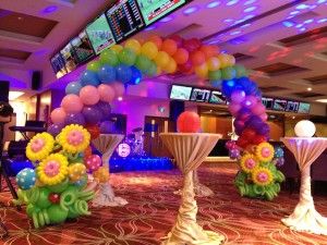 Flowers and Rainbow Balloon Arch
