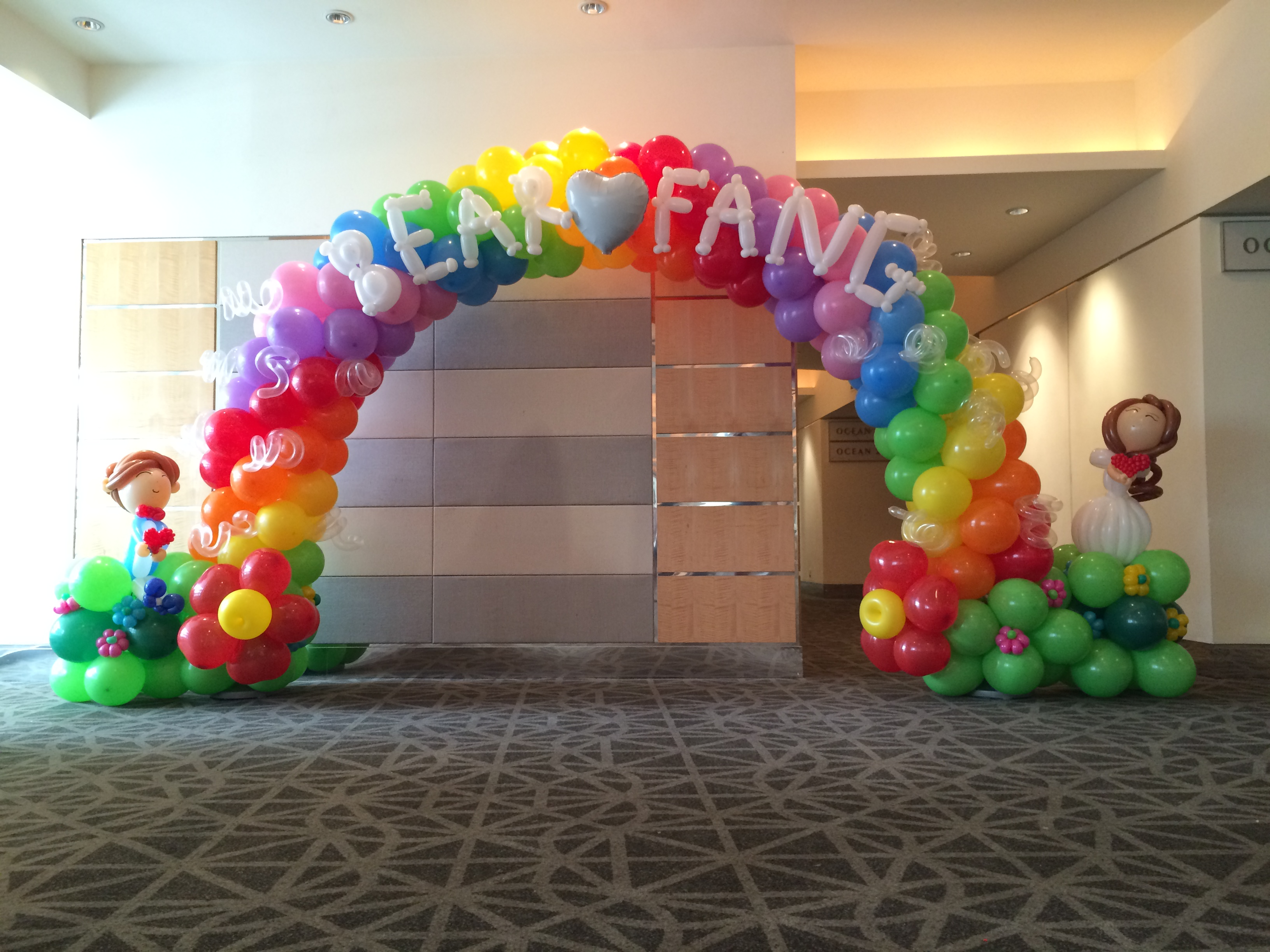 Wedding rainbow balloon arch that balloons for Balloon decoration arches