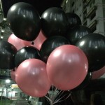 black and pink helium balloons