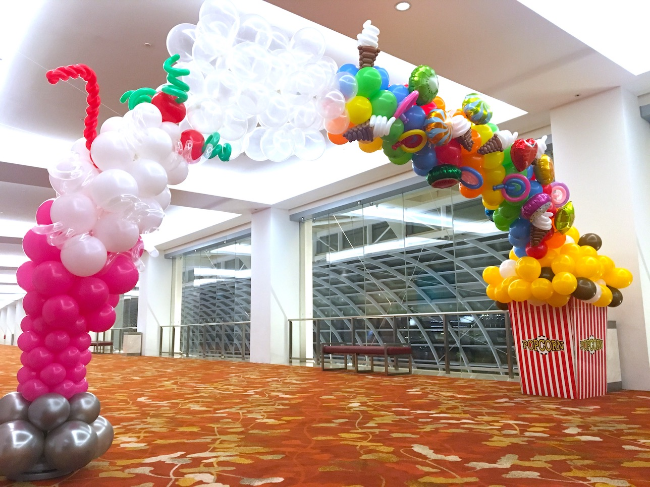 Balloon snacks arch that balloons for Balloon decoration for corporate events