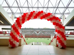 Red and White Spiral Balloon Arch