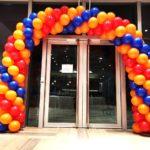 Red Orange and Blue Spiral Balloon Arch