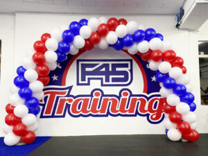 Spiral Red Blue and White Balloon Arch